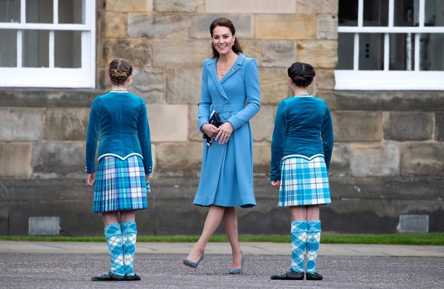 Catherine, Duchess of Cambridge meets Highland dancers during a Beating Retreat by The Massed Pipes and Drums of the Combined Cadet Force in Scotland at the Palace of Holyroodhouse in Edinburgh, Scotland on May 27, 2021, the final day of their week-long visit to the country.
