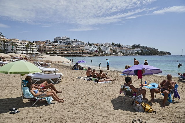 Figueretas beach on Ibiza - UK citizens normally make up the largest share of foreign tourists in Spain    Picture: Andres Iglesias/Getty Images)
