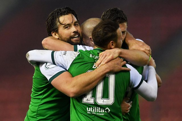 The Hibs players celebrate at full time