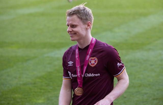 Hearts forward Gary Mackay-Steven with his Championship winner's medal.