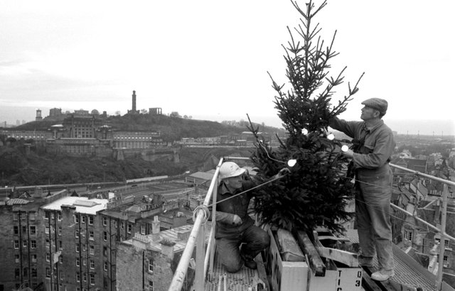 Men from construction company Laing's, working at the High Steet in Edinburgh, decorated their crane with a Christmas tree in December 1985.