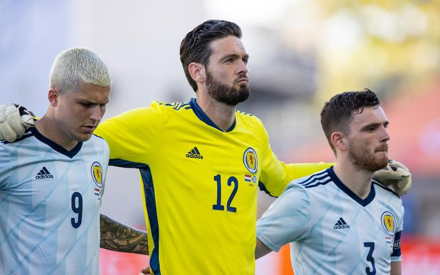 Craig Gordon lines up alongside Lyndon Dykes and Andrew Robertson for the national anthems before Scotland's 2-2 friendly draw with the Netherlands in Wednesday and could be doing so again when the nation embark on their first finals for 23 years in little over a week. (Photo by Craig Williamson / SNS Group)