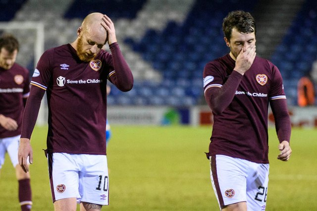 Liam Boyce and Craig Halkett walk off the park at full-time following Hearts 1-1 draw with Inverness last week. Picture: SNS