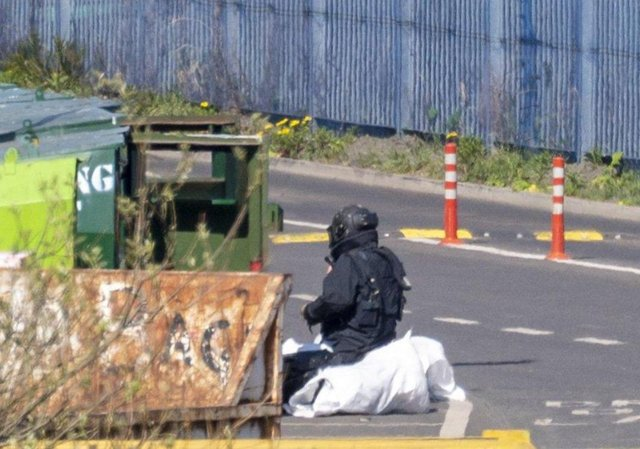 A member of the bomb disposal team inspects the object at Seafield recycling centre. Pic: Andy O'Brien