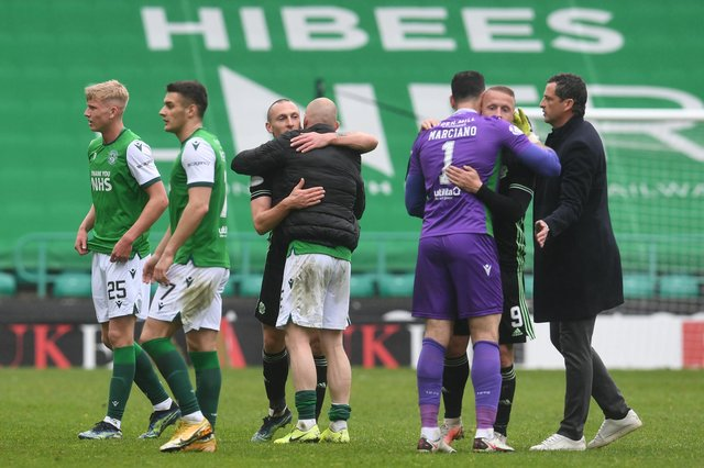 Celtic's Scott Brown with Hibs Alex Gogic, and Celtic's Leigh Griffiths with Hibs Ofir Marciano at full time.