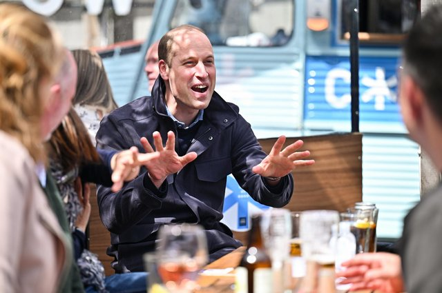 The Duke of Cambridge watches the Scottish Cup Final with emergency responders at the Cold Town House in the Grassmarket rooftop bar in Edinburgh picture: Jeff J Mitchell