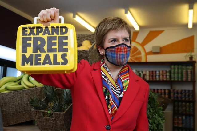 First Minister Nicola Sturgeon holds a lunch box inside The People's Pantry in Glasgow, during campaigning for the Scottish Parliamentary election (PA Media)