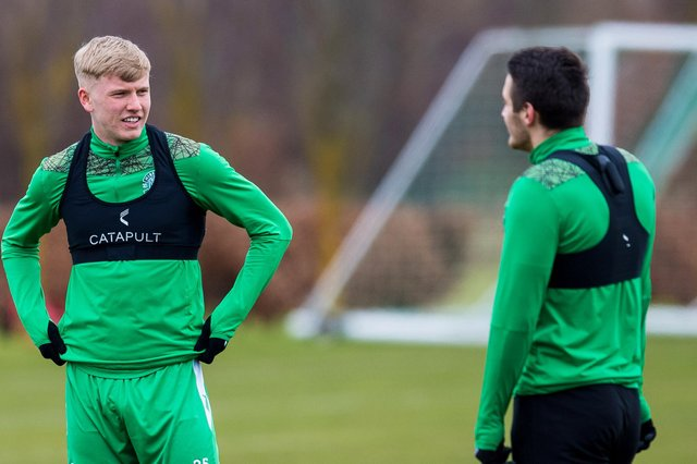 Josh Doig deep in discussion with Kyle Magennis at the Hibernian Training Centre