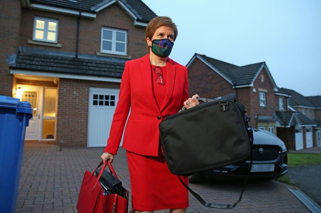 First Minister of Scotland, Nicola Sturgeon, leaves her home in Glasgow to head to Holyrood in Edinburgh to give evidence. Picture: Andrew Milligan/PA Wire