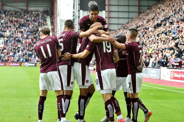 Hearts players surround Juanma Delgado after scoring against St Johnstone on the opening day of the 2015/16 Scottish Premiership season.