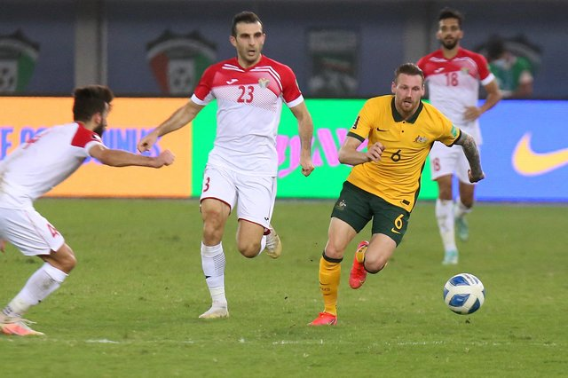 Martin Boyle takes on the Jordanian defence during the 2022 FIFA World Cup qualification group B football match between Australia and Jordan at the Kuwait Sports Club in Kuwait City