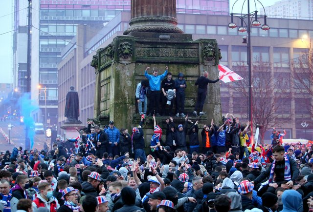 Police said arrests were made and fines were issued after people broke lockdown rules in George Square (PA Media)
