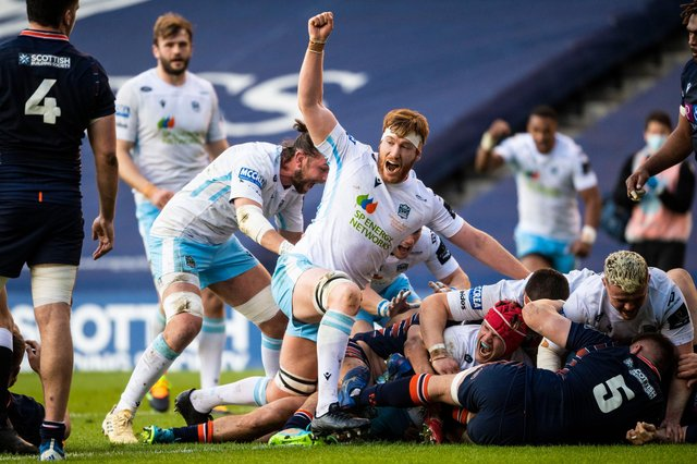 Rob Harley lifts his arm in celebration as Glasgow Warriors hooker George Turner forces his way over for a try. Picture: Ross MacDonald/SNS