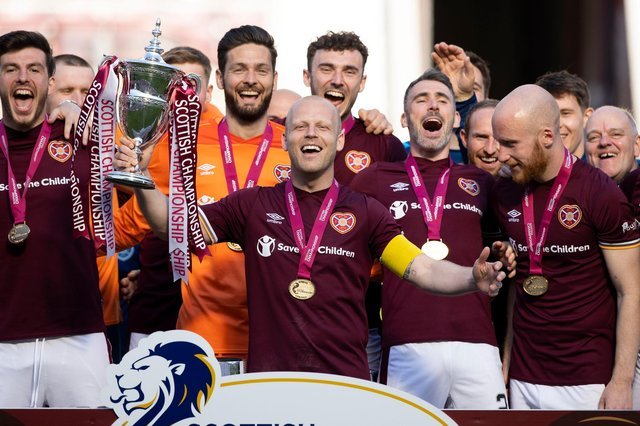 Hearts duo Craig Gordon and Liam Boyce - pictured with team mates during the Championship trophy presentation - have been nomnated for the PFA Championship Player of the Year. (Photo by Craig Williamson / SNS Group)