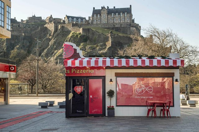 The Two Hearts Pizzeria dining experience in Edinburgh, which Virgin Media is showcasing to bring people closer together and offer guests the chance to share a pizza with a loved one 400 miles apart via hologram, as if sat at the same table.