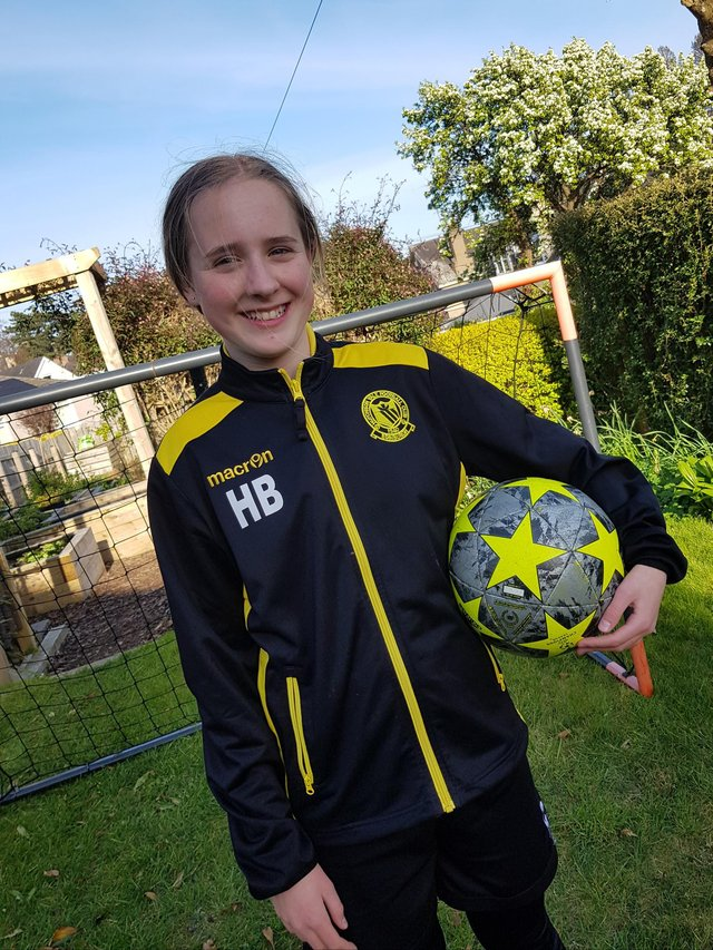Holly Blackham, 13, took part in the Virtual Kiltwalk and was part of more than 60 volunteers who helped dribble a ball from Pittodrie Stadium to Hampden Park