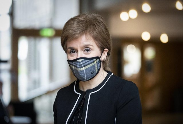 First Minister of Scotland, Nicola Sturgeon, arrives ahead of a Covid briefing at the Scottish Parliament in Holyrood, Edinburgh.