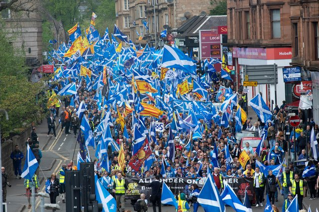 Scottish independence supporters march through Glasgow during the All Under One Banner march.