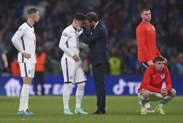 England manager Gareth Southgate consoles Jadon Sancho after defeat in the penalty shootout that decided the Euro 2020 final (Picture: Laurence Griffiths/pool via AP)