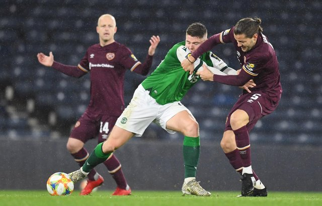 Hibs striker Kevin Nisbet battling for possession against Hearts earlier in the season. Picture: SNS