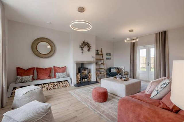 Lounge with log burner.