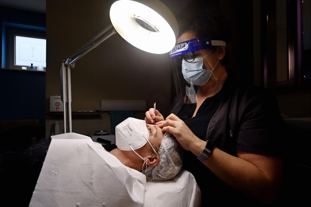 Allowing customers to removemasks for beauty treatmentswould help salons'save themselves from the brink', according to the group (file image). Picture: Eric Lalmand/Belga/AFP via Getty Images.