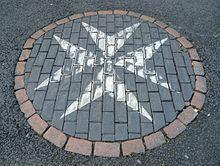 Historic cross on Edinburgh's Royal Mile covered in tarmac