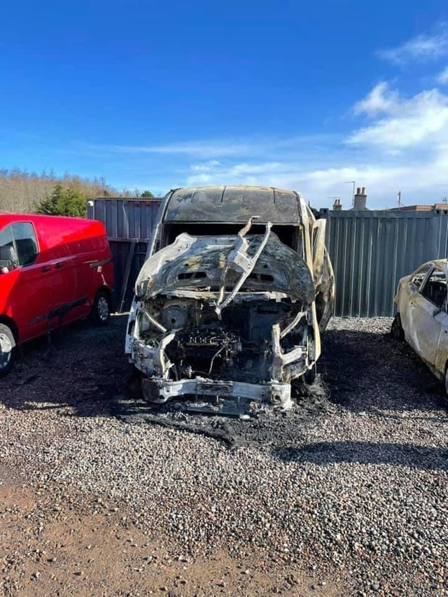 Pictured is one of four cars set on fire at Loanhead Car Sales.