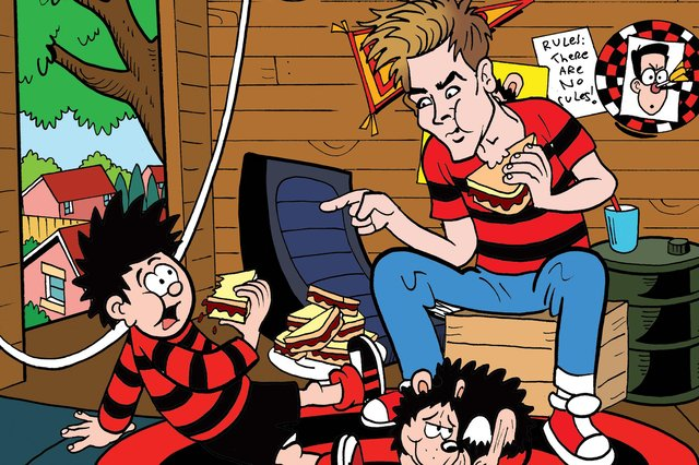 Joe Sugg with Dennis the Menace as the YouTuber and former Strictly Come Dancing star guest-edits a special Beano comic to celebrate 70 years of one of its best-loved characters (Image: Beano Studios)