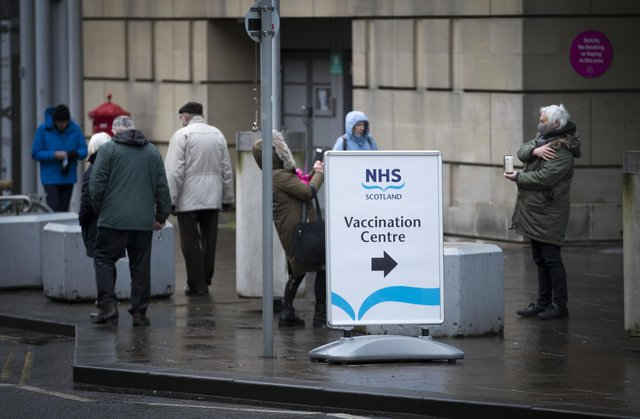 Members of the public outside the main entrance to the coronavirus mass vaccine centre at the Edinburgh International Conference Centre. Picture date: Monday February 1, 2021.