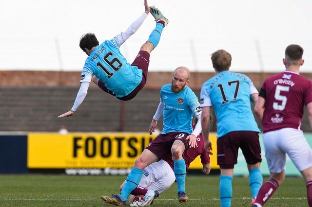Andy Halliday crashes back to earth after trying to evade a first-half challenge. Picture: SNS