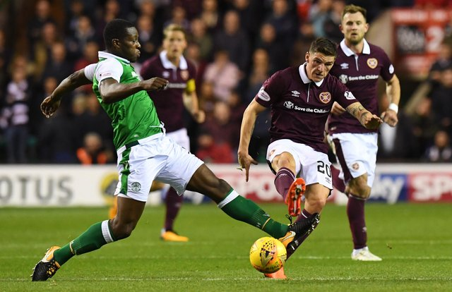 Marvin Bartley challenges former Hearts midfielder Ross Callachan during an Edinburgh derby win for Hibs at Easter Road. Picture: SNS