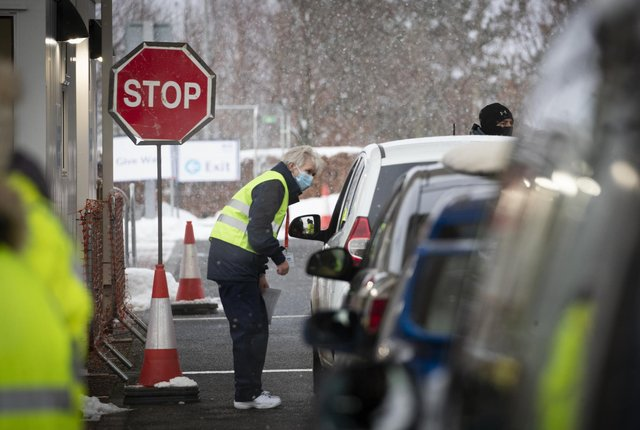 Members of the vaccination team working at the drive-through Covid-19 vaccination centre in the Queen Margaret University Campus, Musselburgh. Picture: PA Media