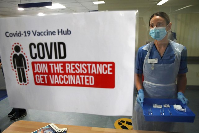 Deputy charge nurse Katie McIntosh prepares to administer Covid-19 vaccine jabs at Edinburgh's Western General Hospital (Picture: Andrew Milligan/PA)