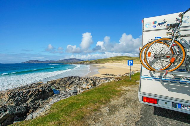 Exploring Scotland in a campervan is popular with travellers keen to keep socially distanced. Trˆigh Iar beach near Horgabost, Isle Of Harris, Outer Hebrides.