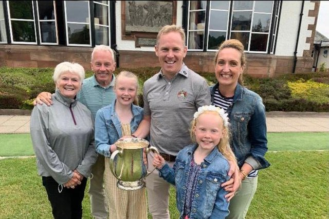 David Miller celebrates with his family after winning the Royal Burgess championship for the first time