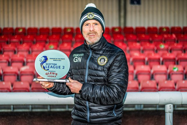 Gary Naysmith shows off his Glen's Manager of the Month award at Ainslie Park