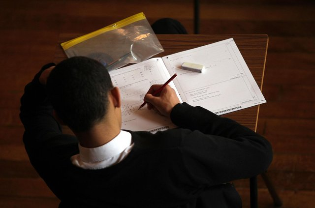 A teenager taking a exam. Picture: David Davies/PA Wire