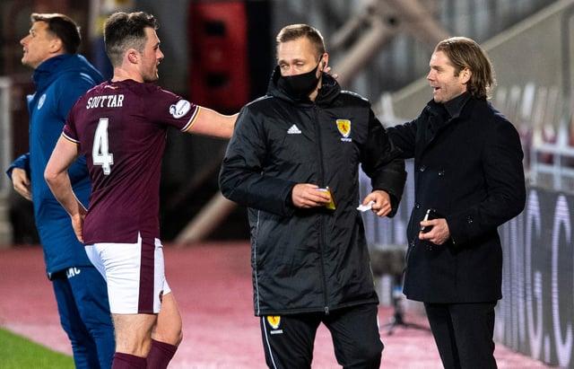 Robbie Neilson congratulates John Souttar on his return to the Hearts team.