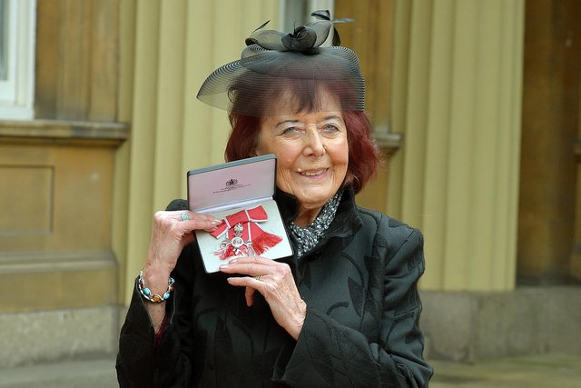 Author Alanna Knight poses with her MBE in 2014