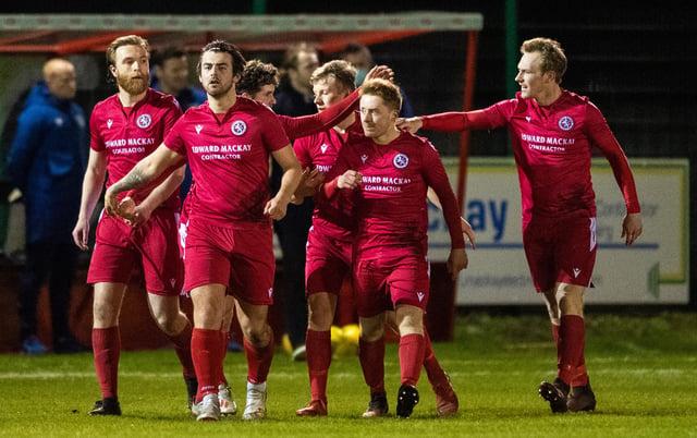 Brora players celebrate Jordan MacRae's goal to make it 1-0 against Hearts