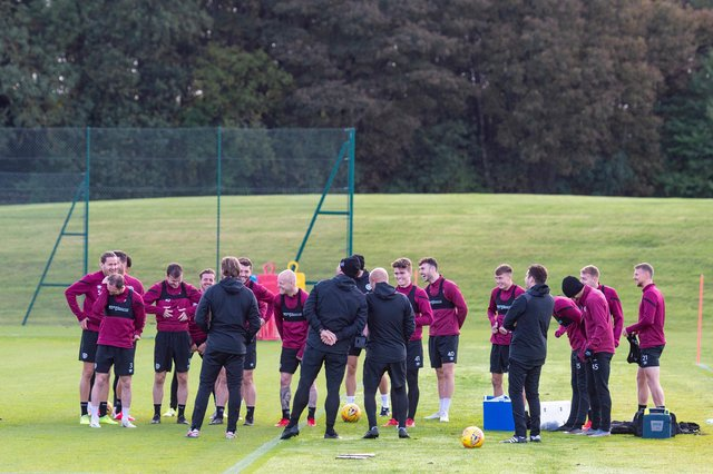 The Hearts squad will meet on Friday to discuss if they will accept the Championship trophy.