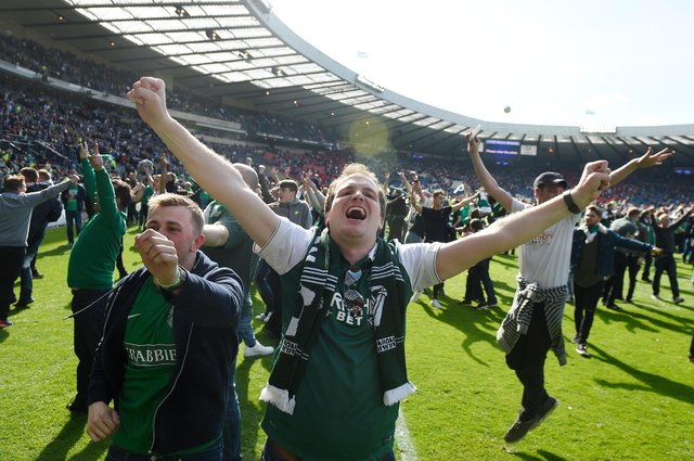 Hibs - fans on the pitch at full time. Pic Greg Macvean