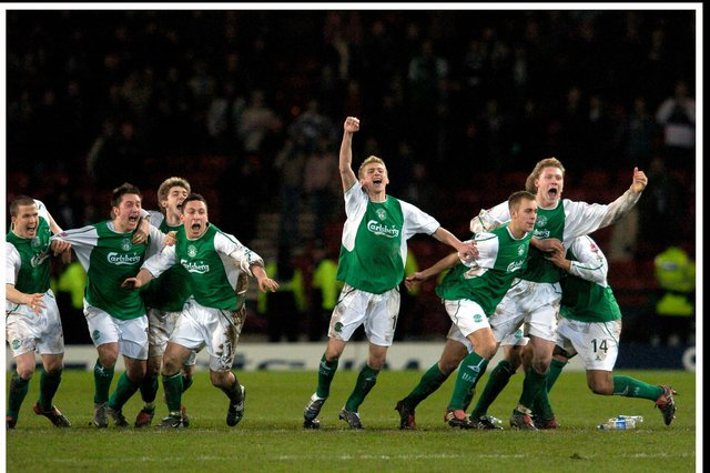 Hibs players -including Stephen Dobbie, second from left - celebrate their penalty shoot-out victory over Rangers in the 2004 League Cup semi-final ... Pic Donald MacLeod 05.02.04