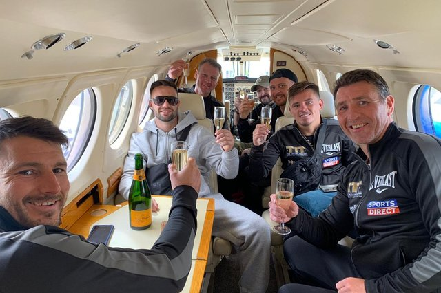 Josh Taylor and his team sip champagne in a private jet on the final leg of their journey home to Scotland. Picture: MTK Global Boxing