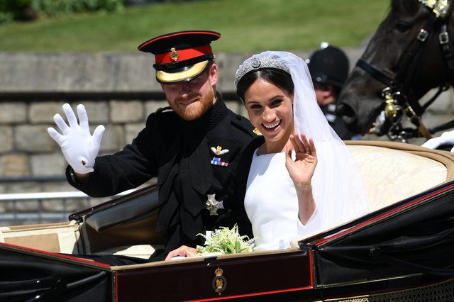 Prince Harry and Meghan Markle ride in an Ascot Landau after their wedding ceremony at St George's Chapel in Windsor Castle (Picture: Paul Ellis/PA)