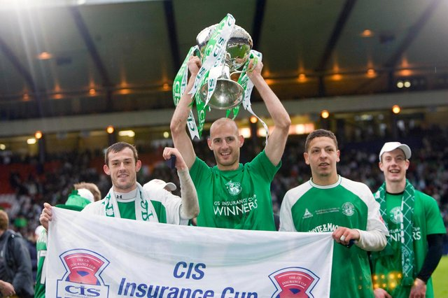 Hibs captain Rob Jones holds aloft the CIS Cup after the 5-1 win over Kilmarnock at Hampden on March 18, 2007. Pic: SNS