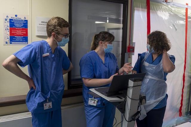 Doctors and nurses inside the RIDU, Regional Infectious Diseases Unit at Edinburgh's Western General.