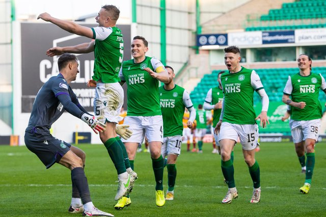 Ryan Porteous celebrates with his Hibs team-mates after scoring the winning penalty against Motherwell. Picture: SNS