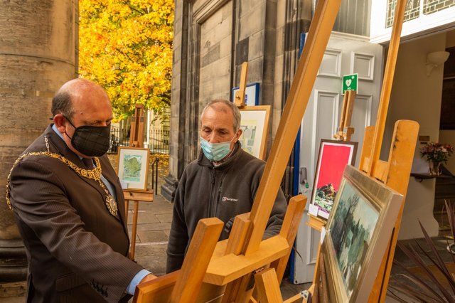 The Lord Provost admires some of the paintings at Christian Aid's sale of pictures with James Holloway, former director of the Scottish National Portrait Gallery, who is pictures convener for the sale.